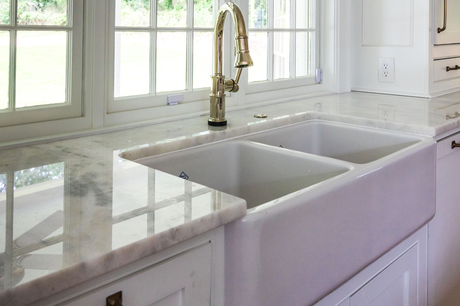 MARBLE KITCHEN COUNTERTOPS WITH A FARMHOUSE SINK
