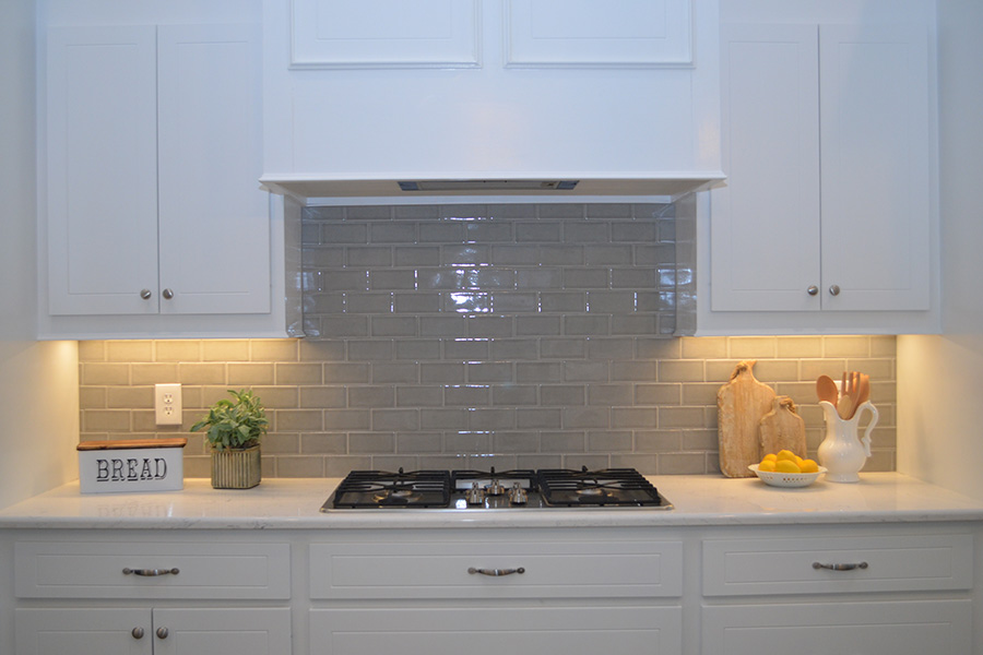 quartz counter top with gray subway tile