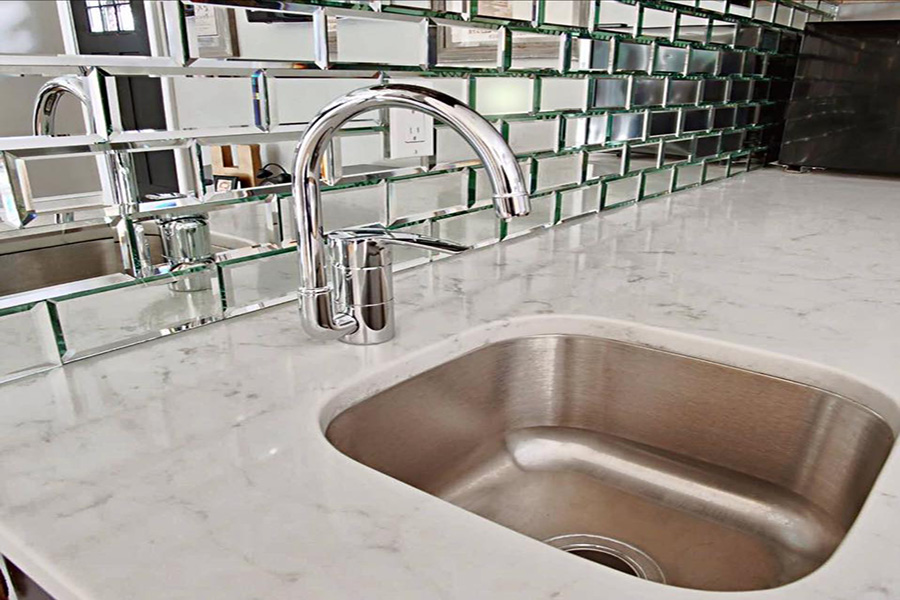 bianco venata quartz with beveled antique glass