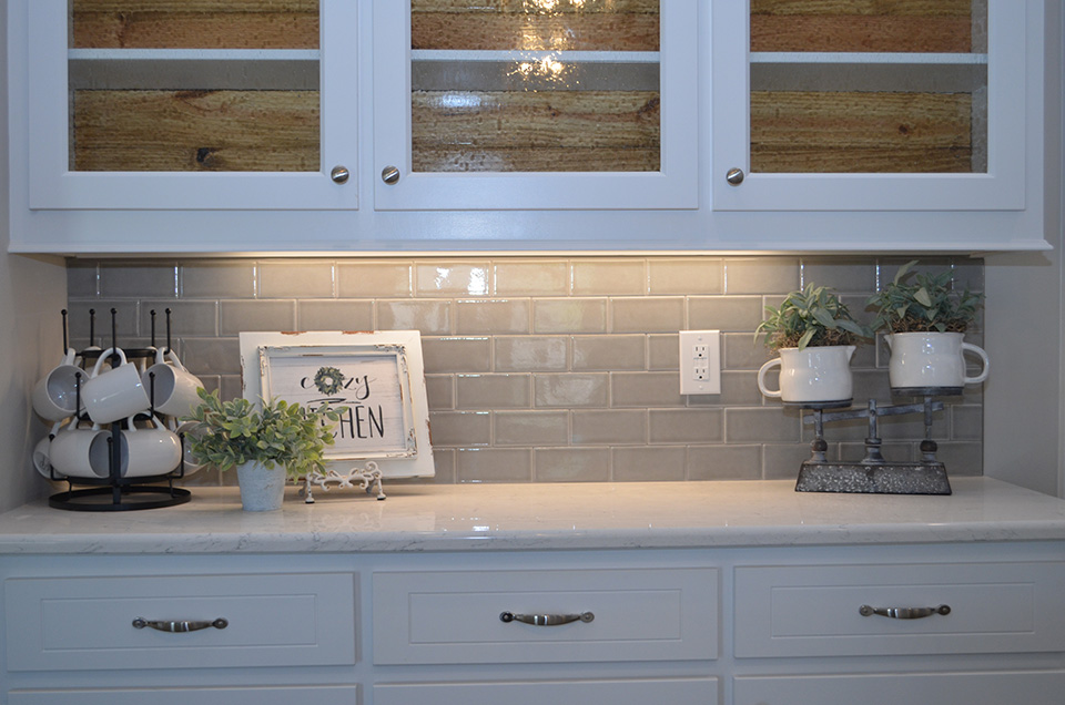 Carrara mist quartz with dove gray backsplash