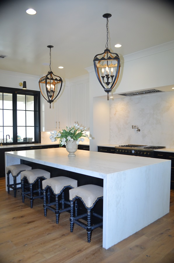 Mystery White leathered kitchen with waterfall island and full height backsplash